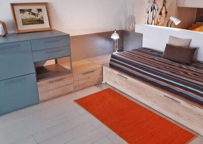 dormitori juvenil amb llit niu