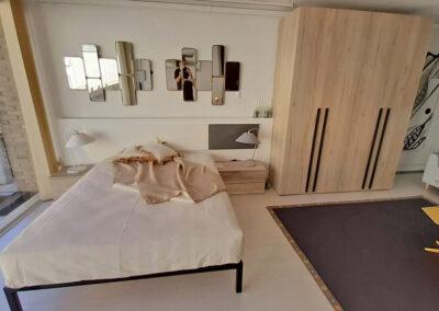 dormitori matrimoni de fusat amb armari i
